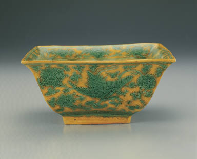 Square brush washer with incised phoenix design in green and bright yellow enamels