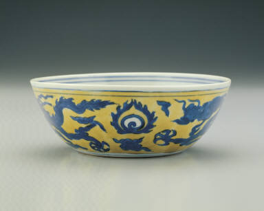 Bowl with dragons chasing pearls in underglaze blue on a yellow ground