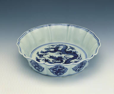 A blue-and-white washer with cloud and dragon motif