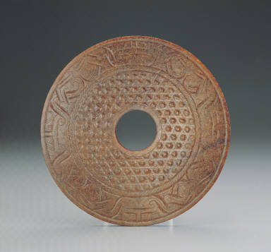Jade bi disk with twin-bodied animal mask design