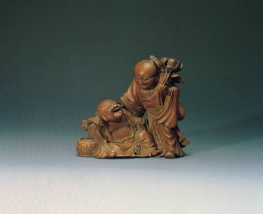 Bamboo carving of the auspicious motif of two monks in harmonious union