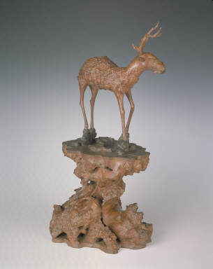 Gnarled wood carving of the auspicious deer and lingzhi motifs
