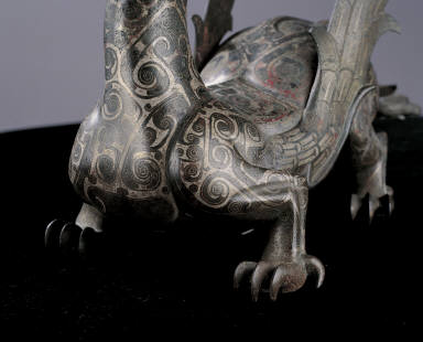 Bronze winged mythical animal inlaid with silver