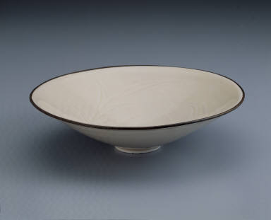 Bowl with incised waterfowl and lotus pond design in white glaze
